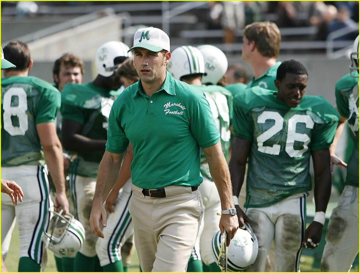 we are marshall the movie Other than one incomplete pass at the beginning of the film, the first hour of we are marshall is a sports movie without any sports there's a plane crash.