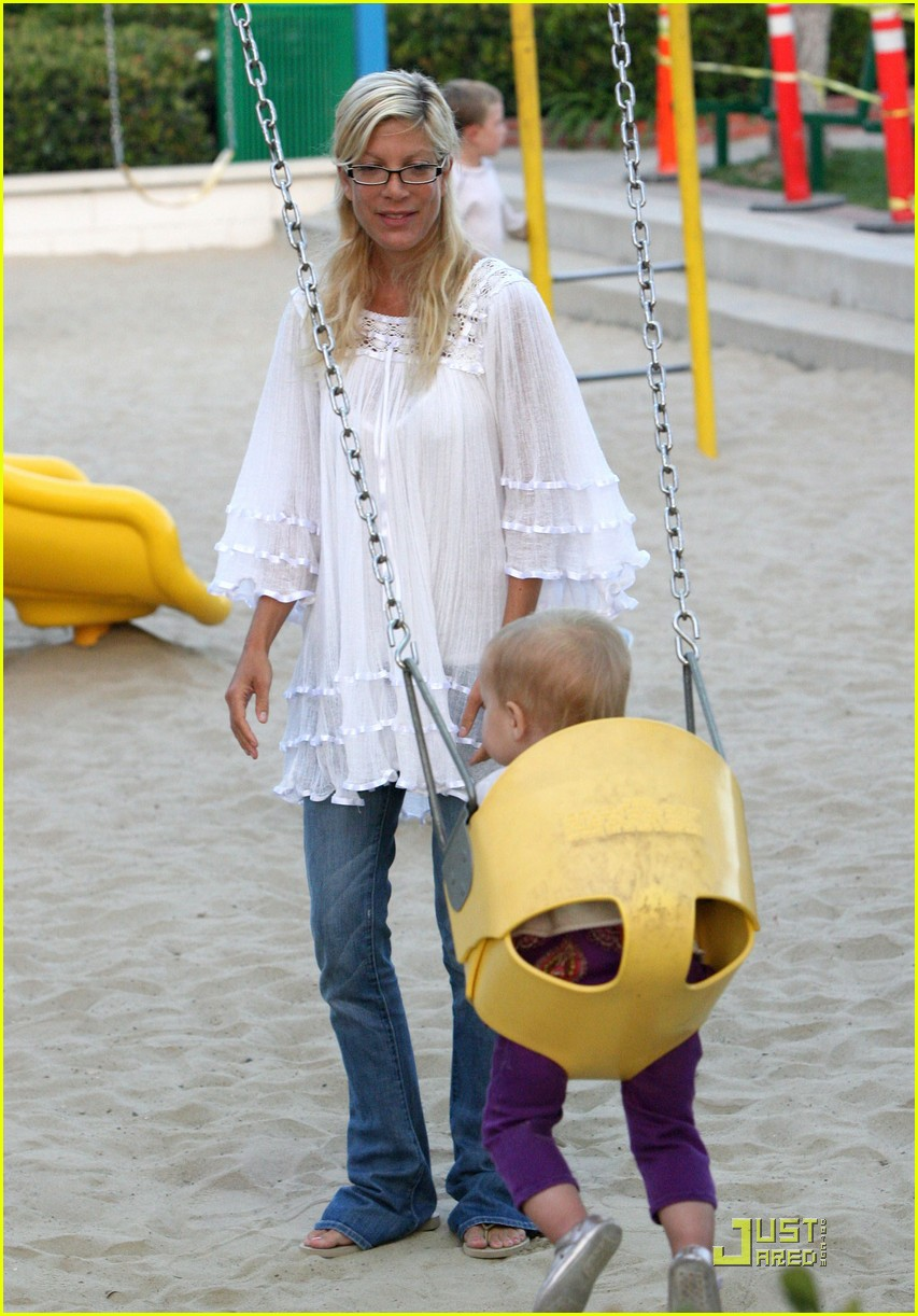 tori spelling kids play at the park 152144352