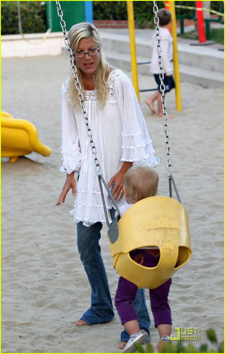 tori spelling kids play at the park 202144402
