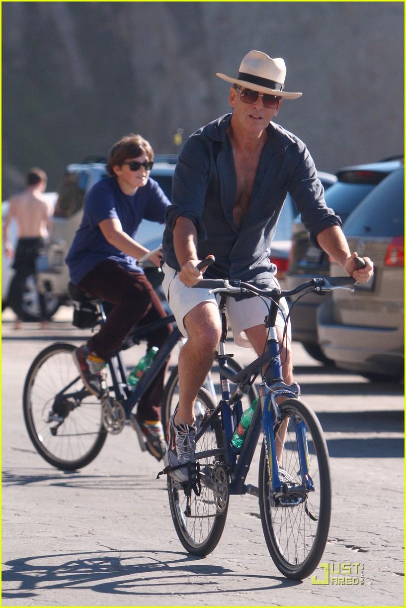 pierce brosnan beach bicycling 072386922