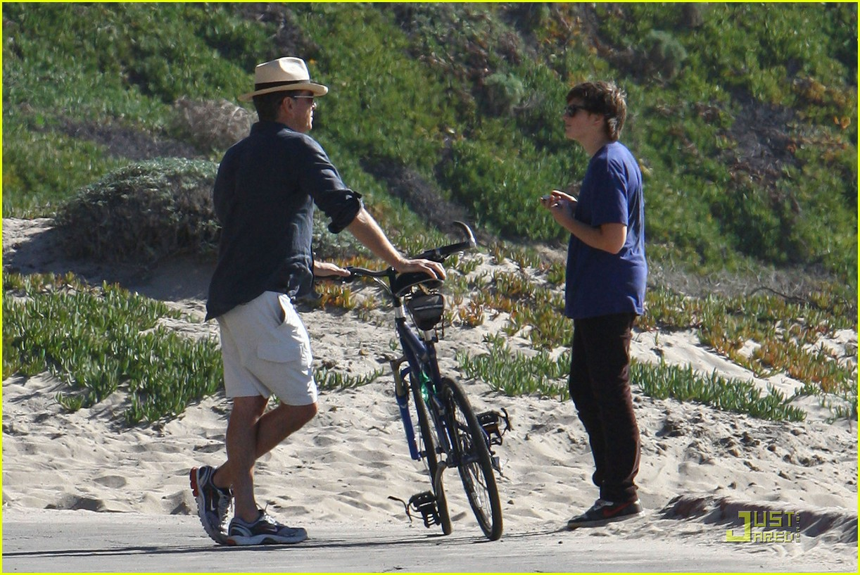 pierce brosnan beach bicycling 112386962