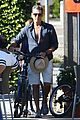 pierce brosnan beach bicycling 05