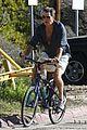 pierce brosnan beach bicycling 10