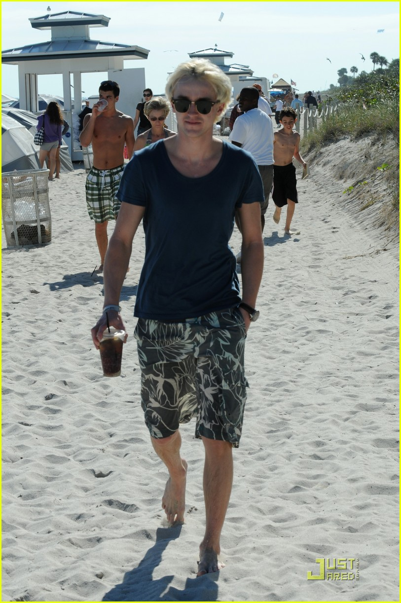 tom felton romantic beach stroll girlfriend 062404838