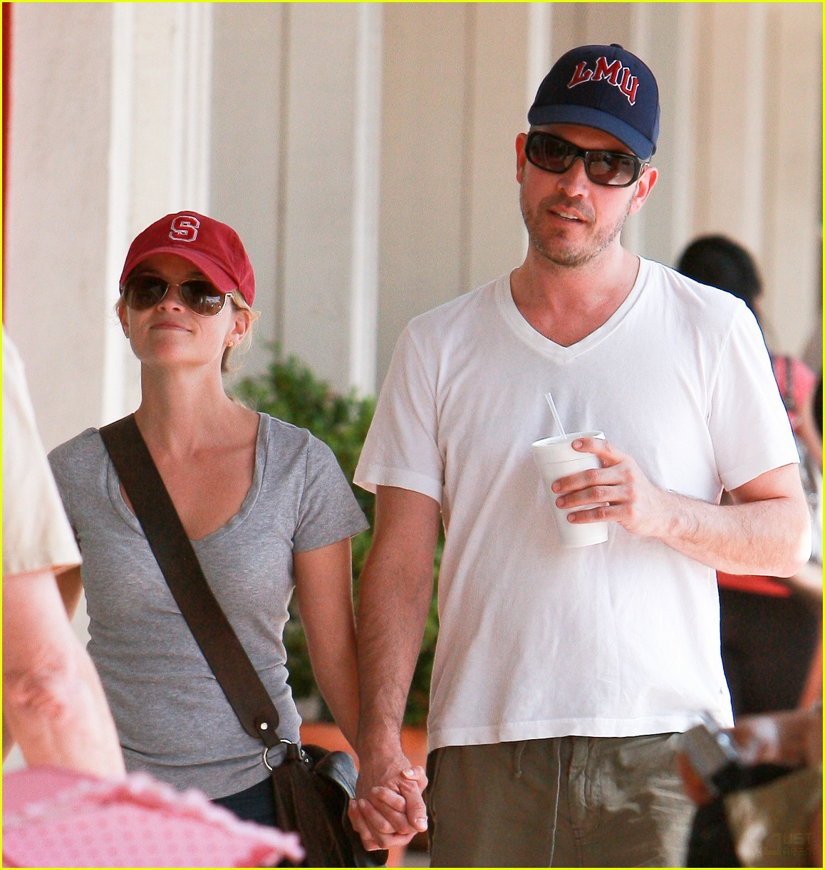reese witherspoon jim toth holding hands 162436230