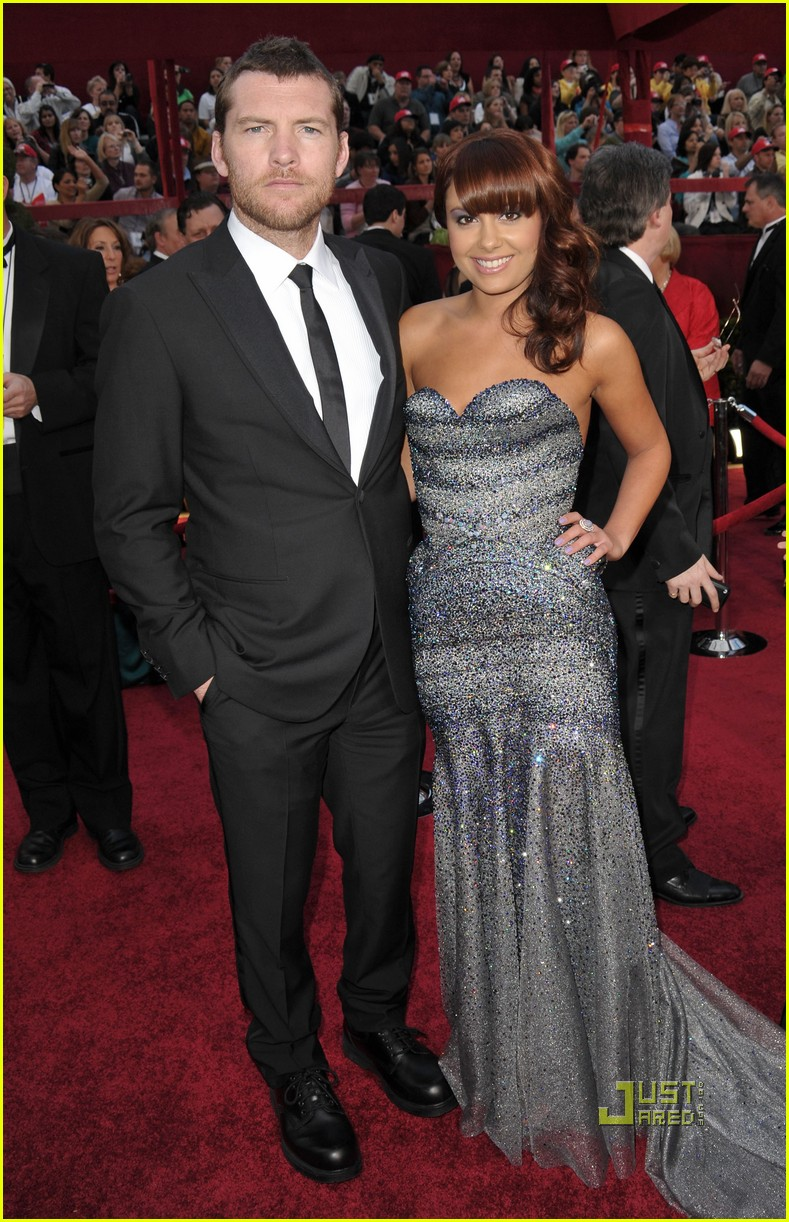 sam worthington natalie mark 2010 oscars red carpet inside 01
