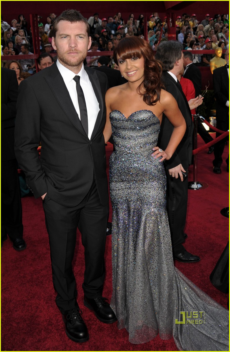 sam worthington natalie mark 2010 oscars red carpet inside 072433362