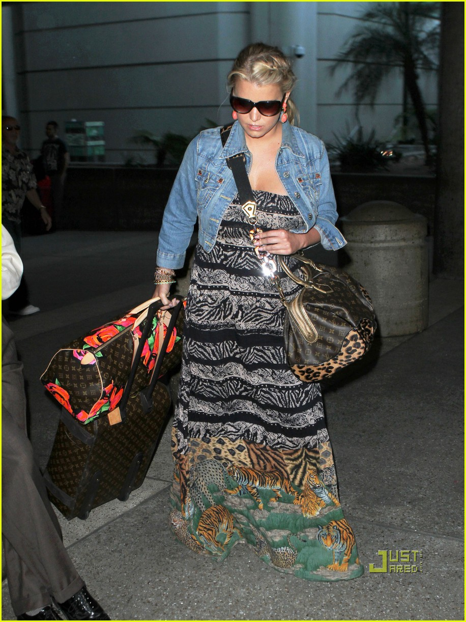 jessica simpson eric johnson home from italy 05