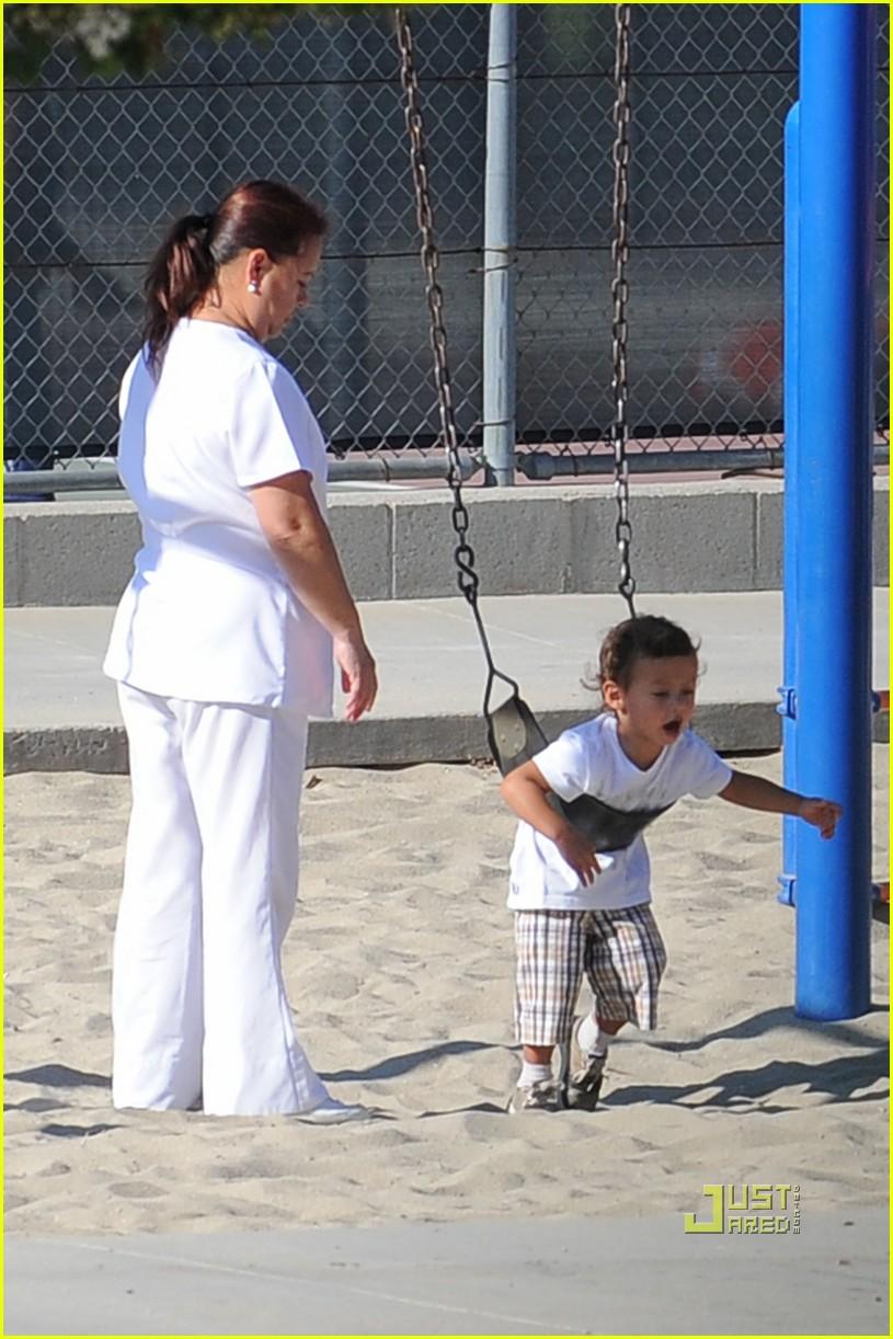 jennifer lopez swinging and sliding with family 132472517