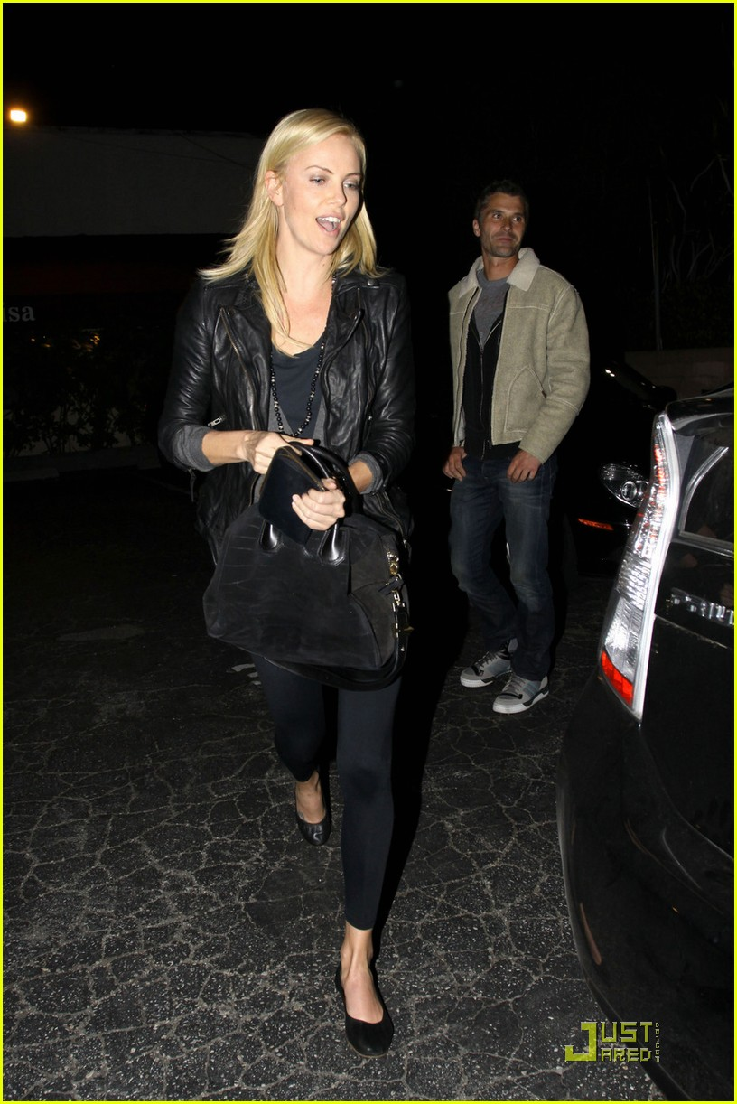 charlize theron dines with a mystery male 012524474