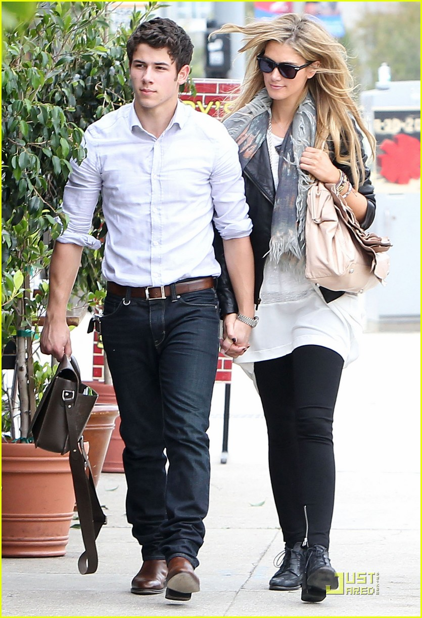 Full Sized Photo of nick jonas delta goodrem holding hands ...