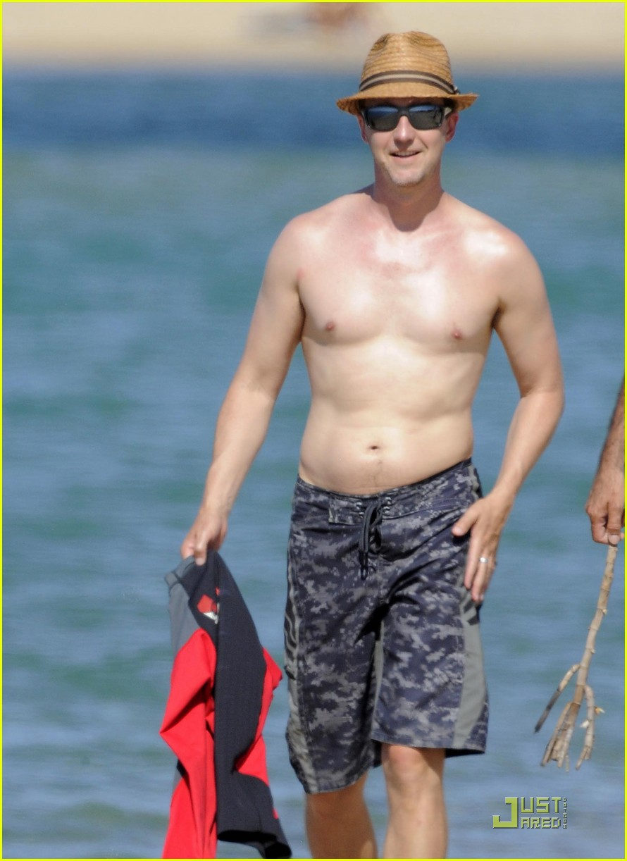 The Leo with shirtless slim body on the beach