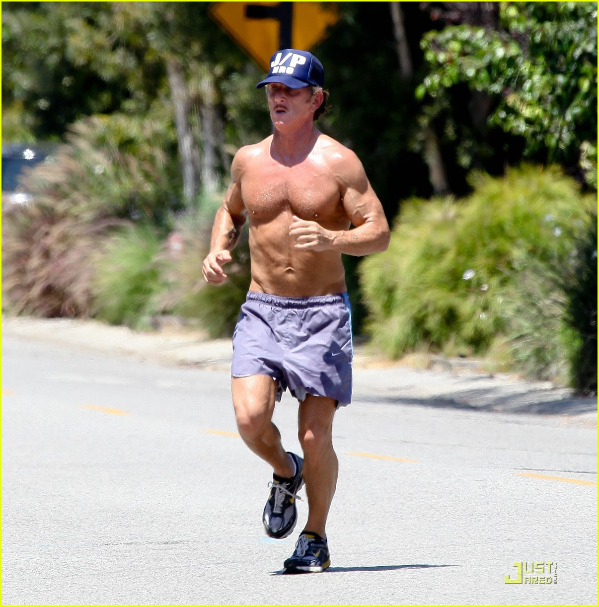 sean penn shirtless jogging with shannon costello 01