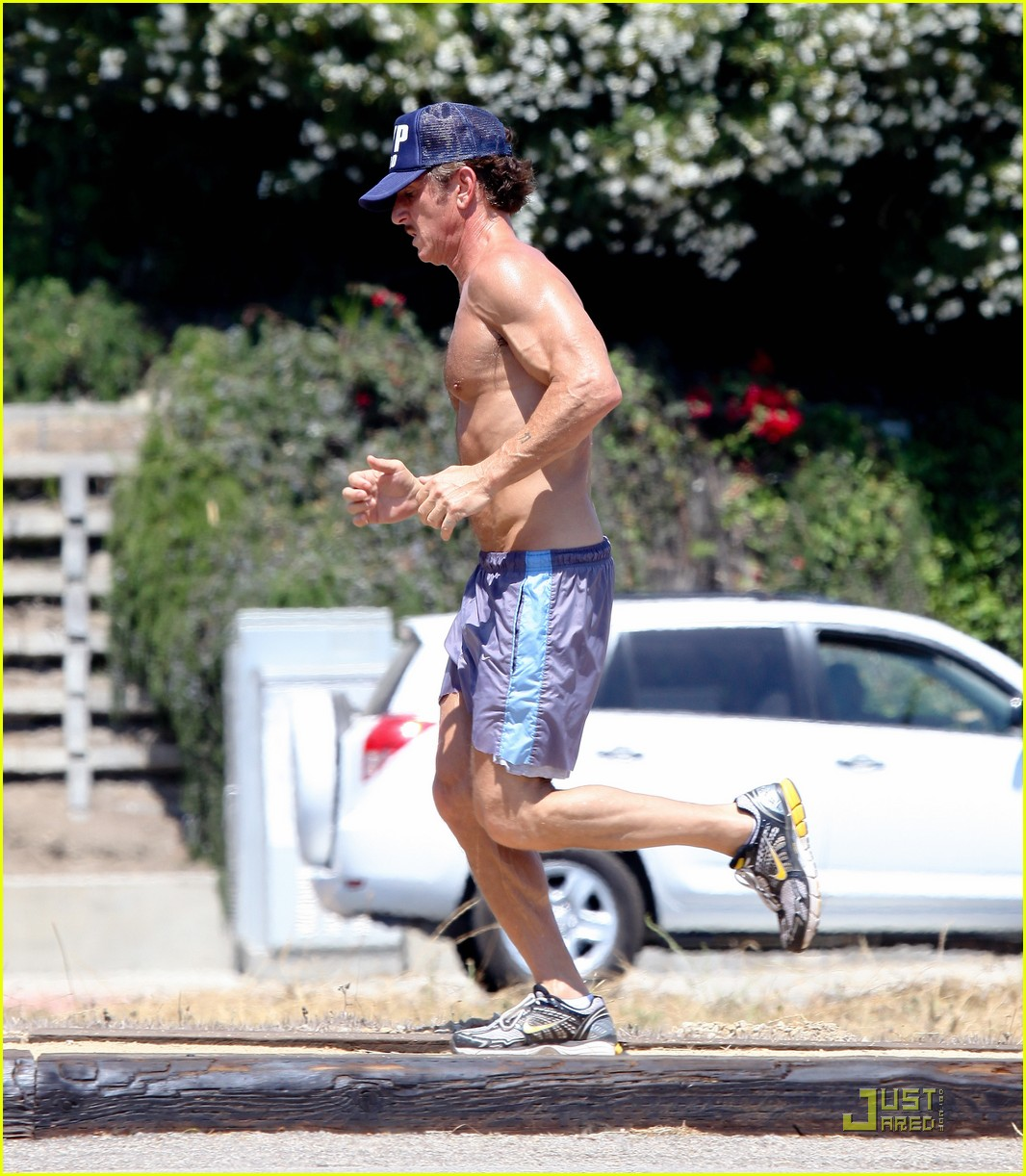 sean penn shirtless jogging with shannon costello 212574298