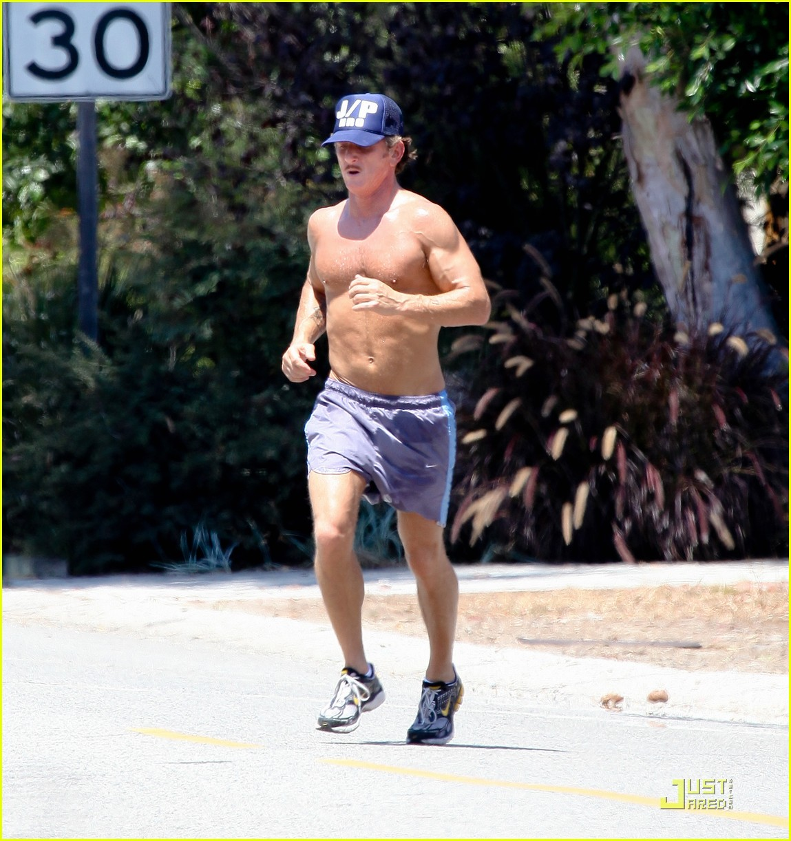 sean penn shirtless jogging with shannon costello 262574303