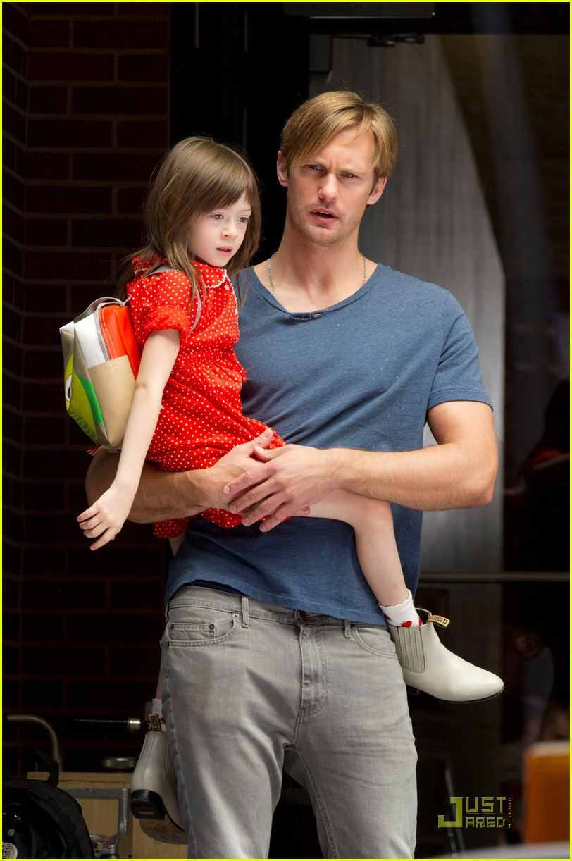 alexander skarsgard carries maisie young costar 032575080