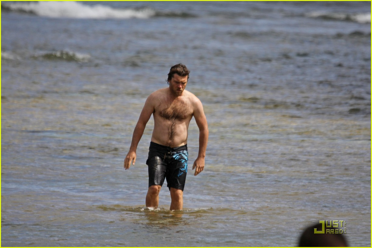 The Leo with shirtless athletic body on the beach