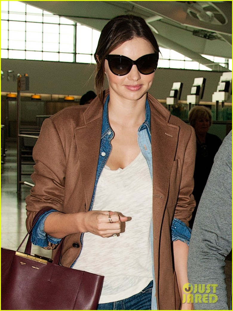 miranda kerr orlando bloom heathrow flynn 03