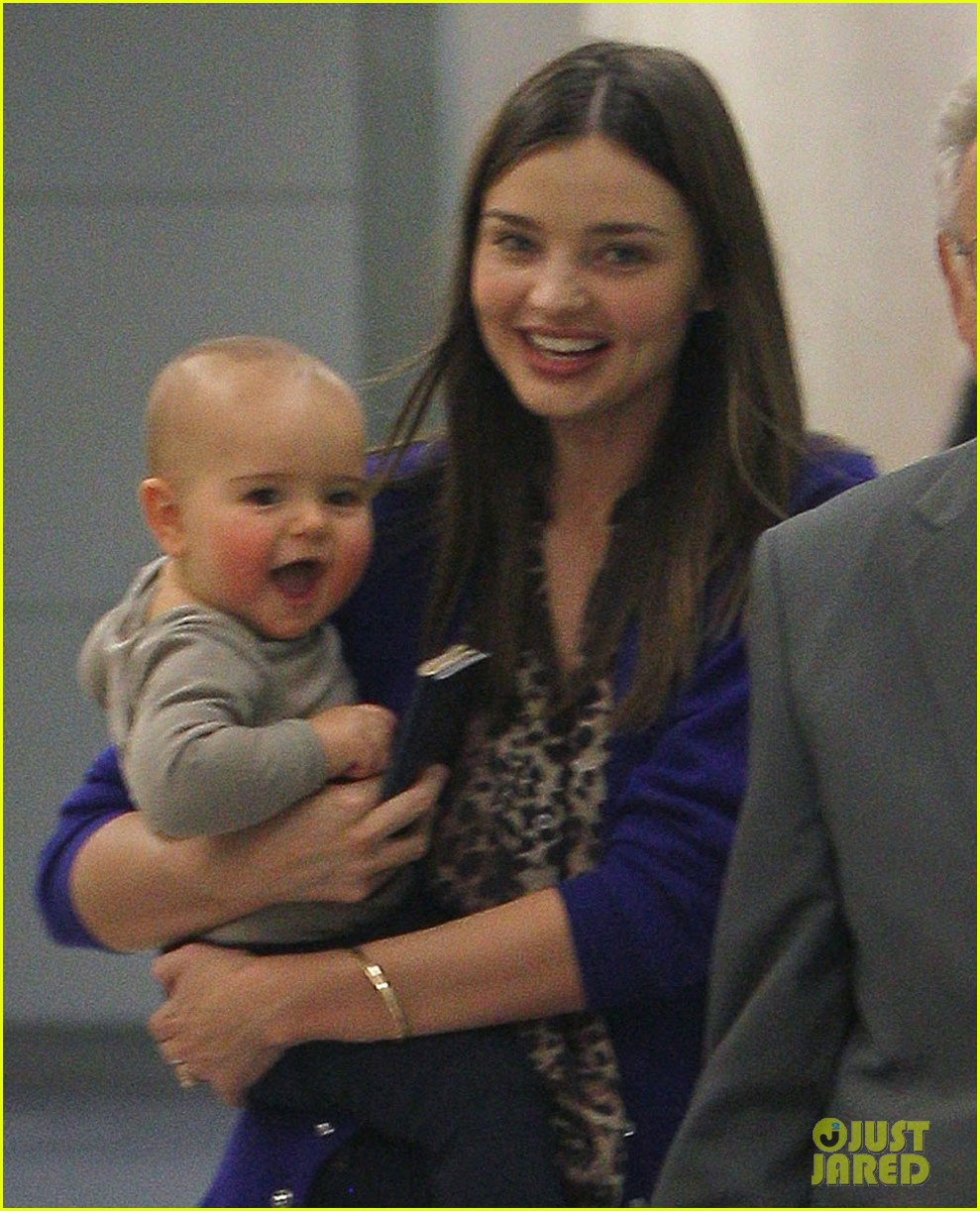 Miranda Kerr and adorable baby Flynn touch down