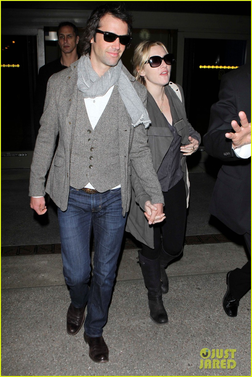 kate winslet ned rocknroll hold hands lax 022617571