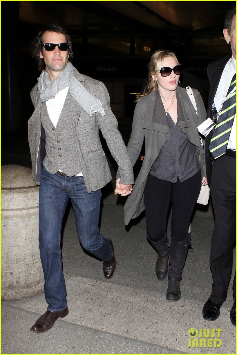kate winslet ned rocknroll hold hands lax 032617572