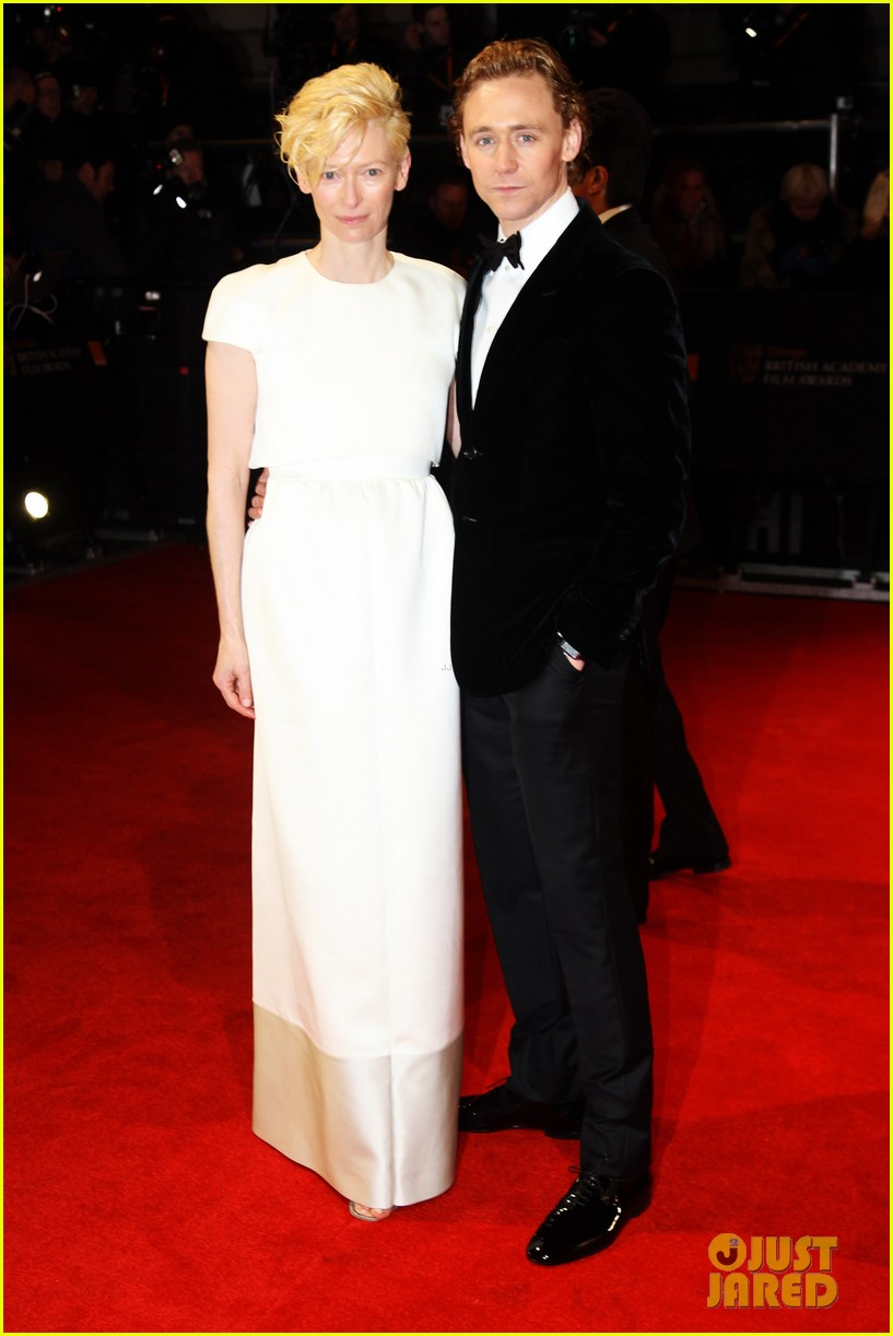 tom hiddleston tilda swinton 2012 baftas red carpet 132628016