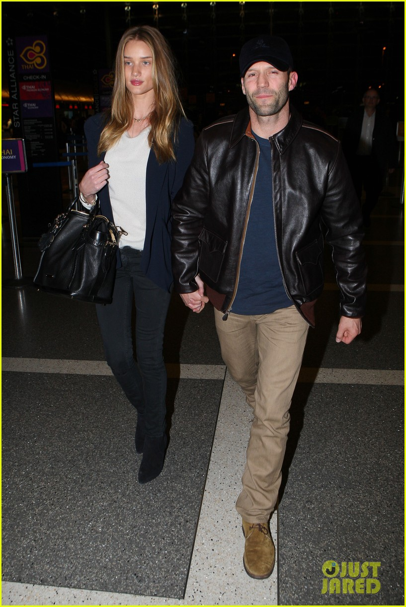 rosie huntington whiteley jason statham holding hands lax 062635100
