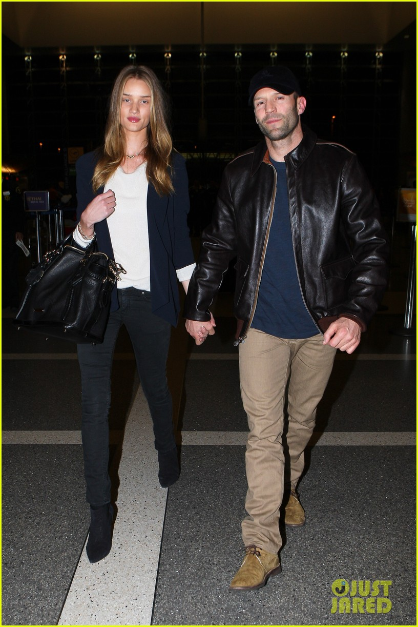 rosie huntington whiteley jason statham holding hands lax 082635102