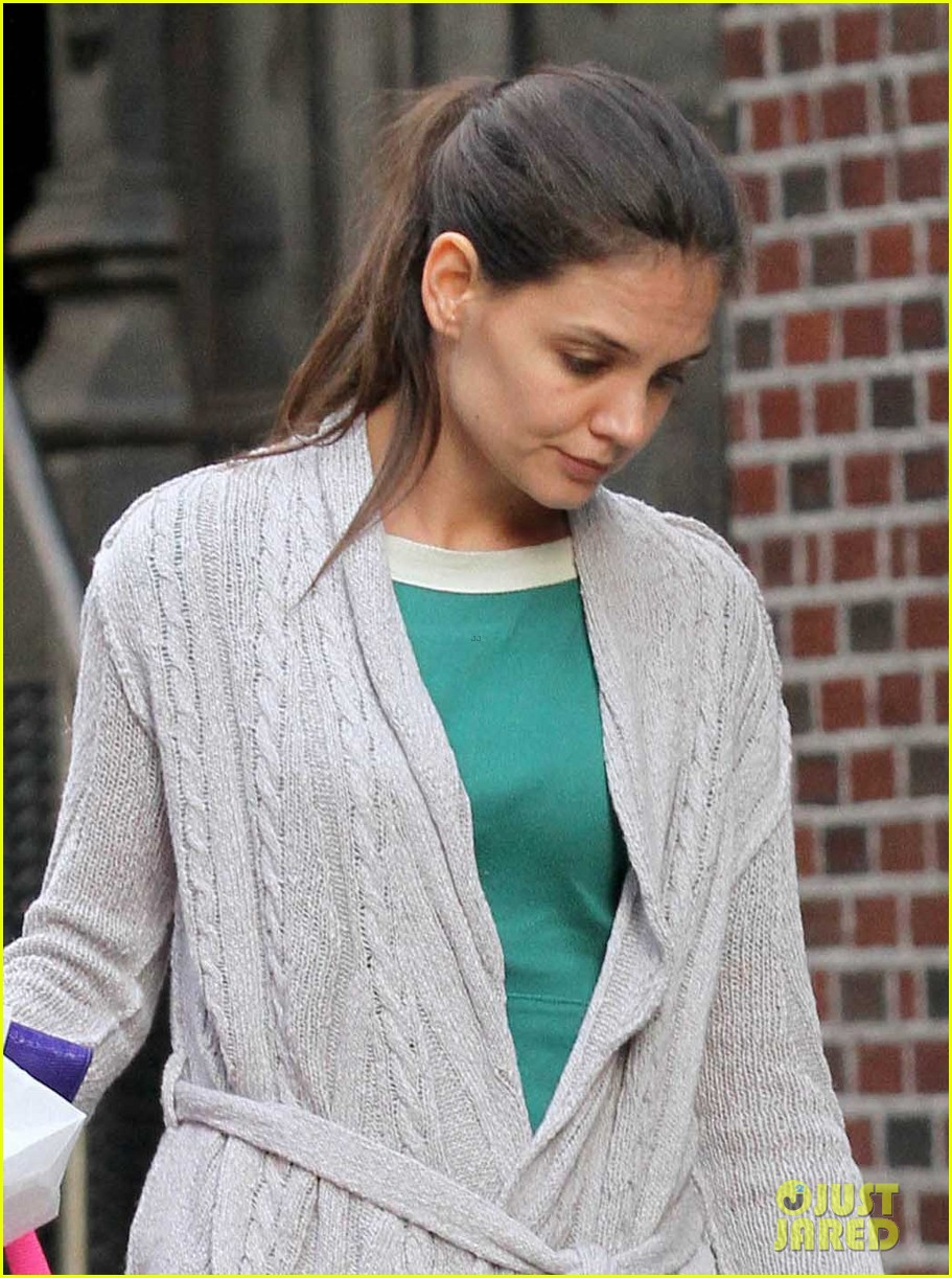 suri cruise sticks tongue out at katie holmes 022653373