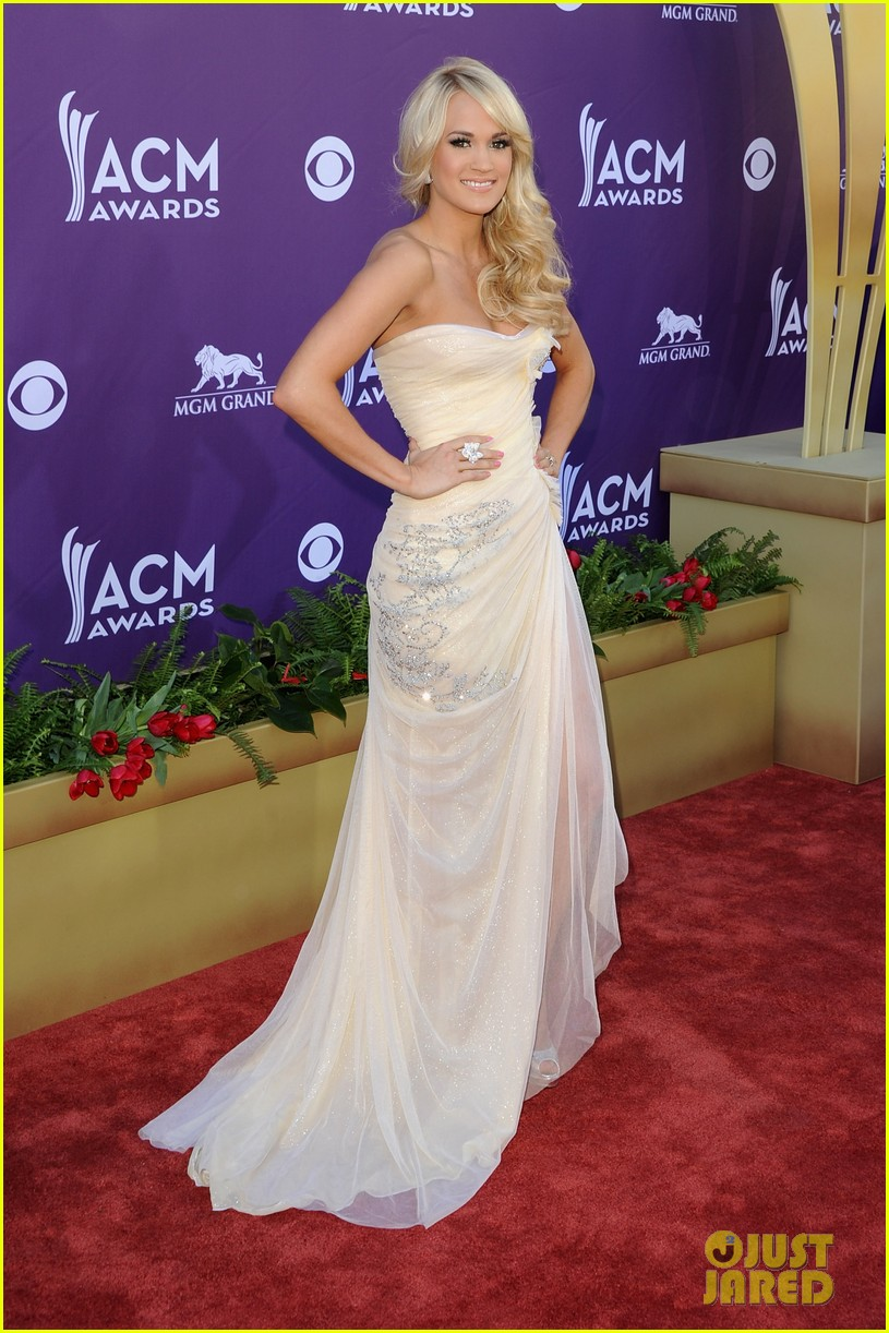Is Carrie Underwood pregnant? Check out photos from ACM
