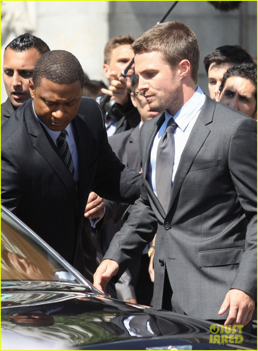 stephen amell suits up on arrow set 24