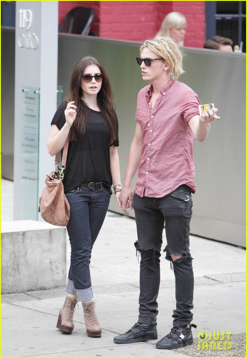 lily collins jamie campbell bower hold hands toronto 032685145