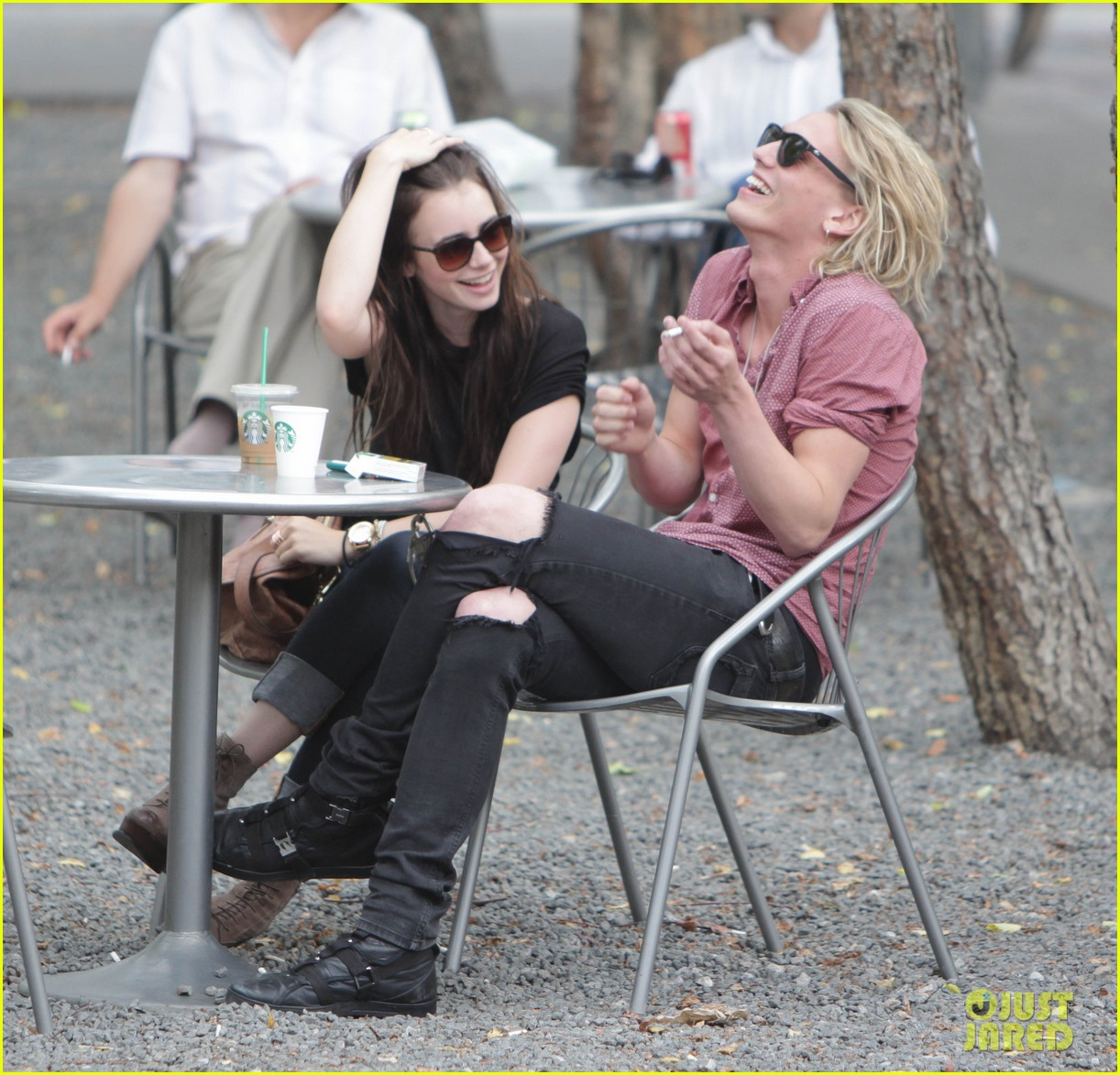 lily collins jamie campbell bower hold hands toronto 04