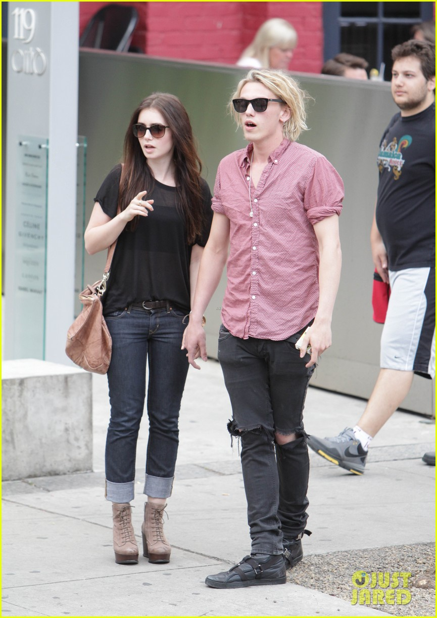 lily collins jamie campbell bower hold hands toronto 052685147