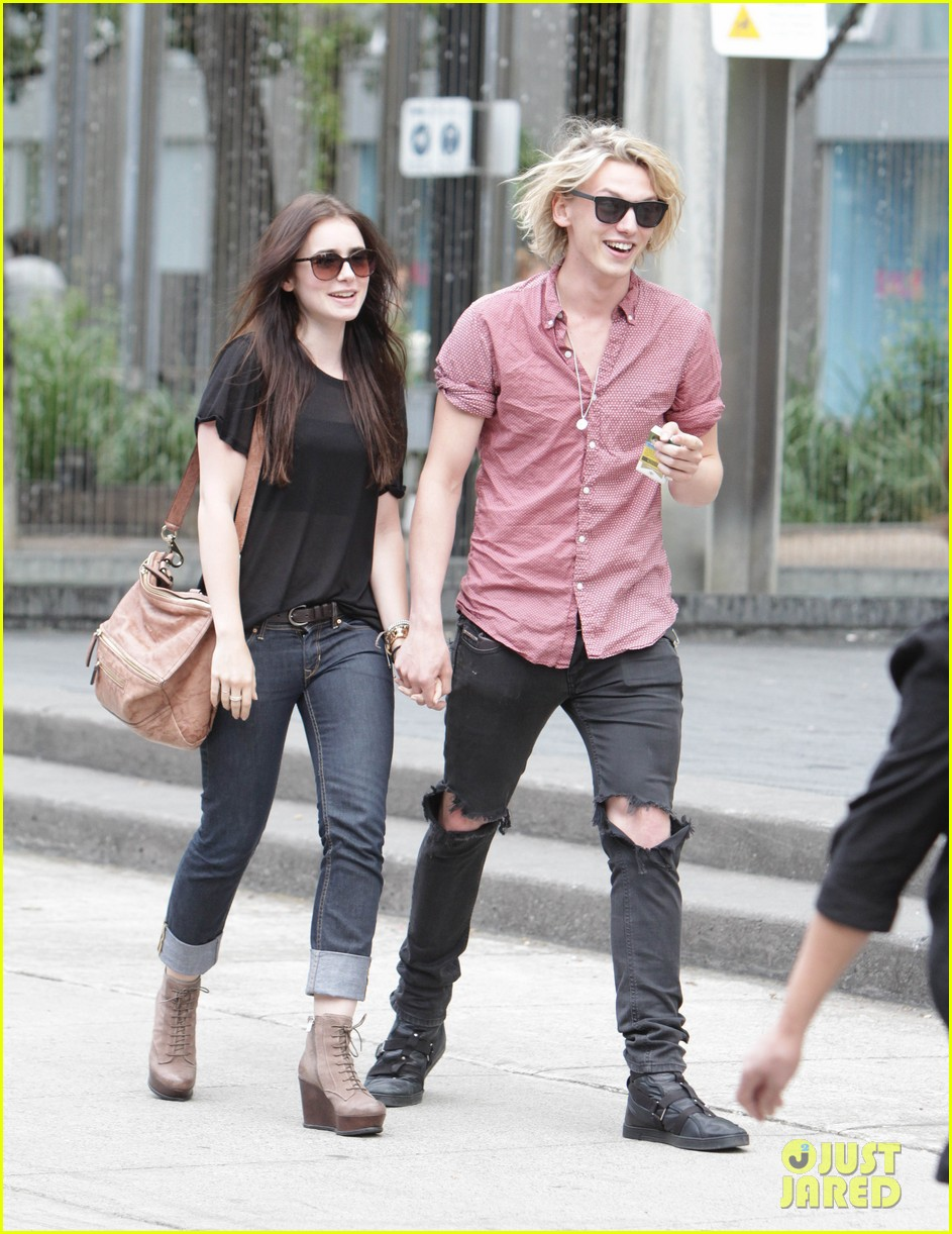 lily collins jamie campbell bower hold hands toronto 072685149