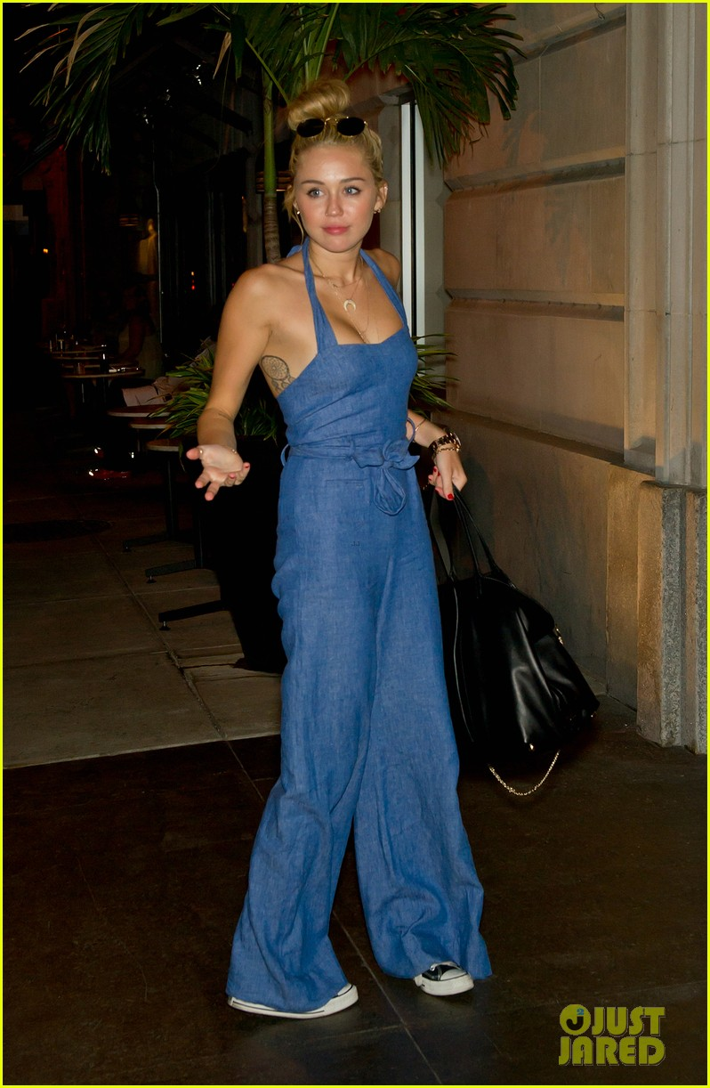 miley cyrus denim jumpsuit with liam hemsworth 012689582