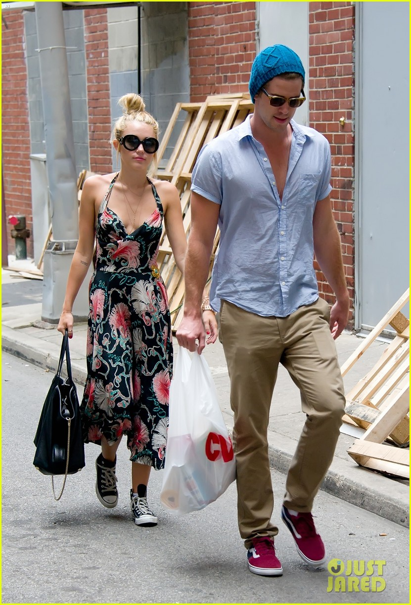 miley cyrus denim jumpsuit with liam hemsworth 052689586