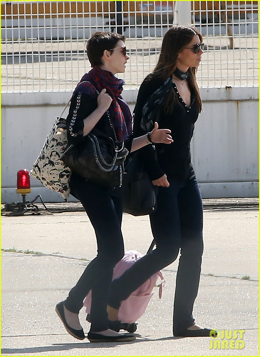 anne hathaway christian bale leaving paris 02