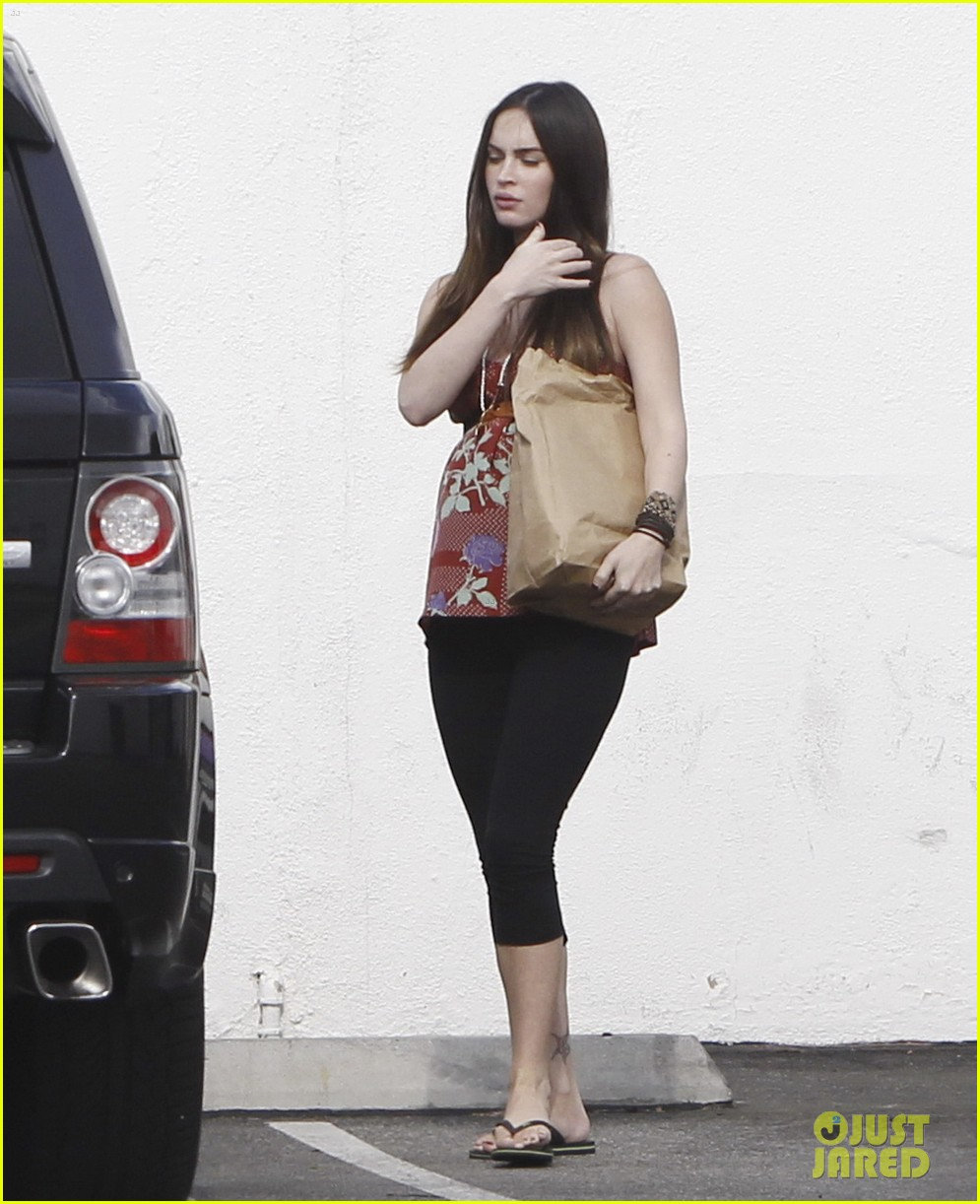 megan fox covers growing baby bump 132711849