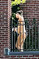 gisele bundchen bikini baby bump on balcony 02