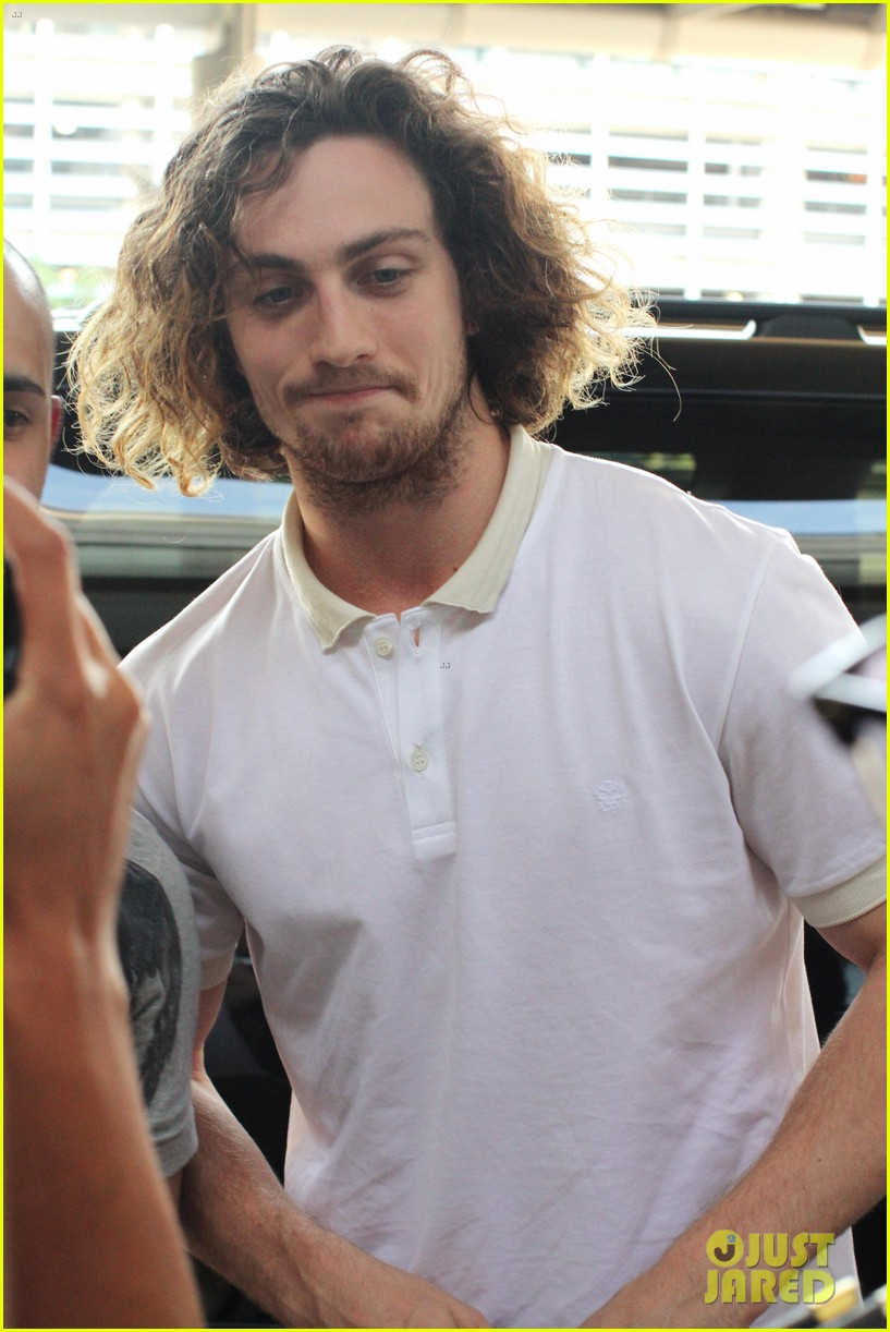 aaron taylor johnson airport with sam wylda rae romy hero 142714902