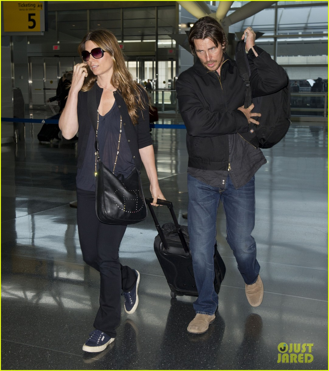 christian bale jfk airport arrival with sibi blazic 01