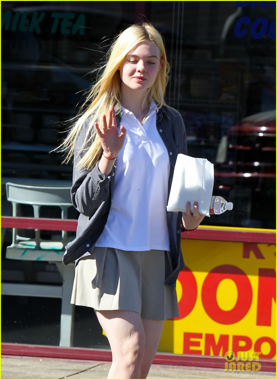 elle fanning showing some leg 09