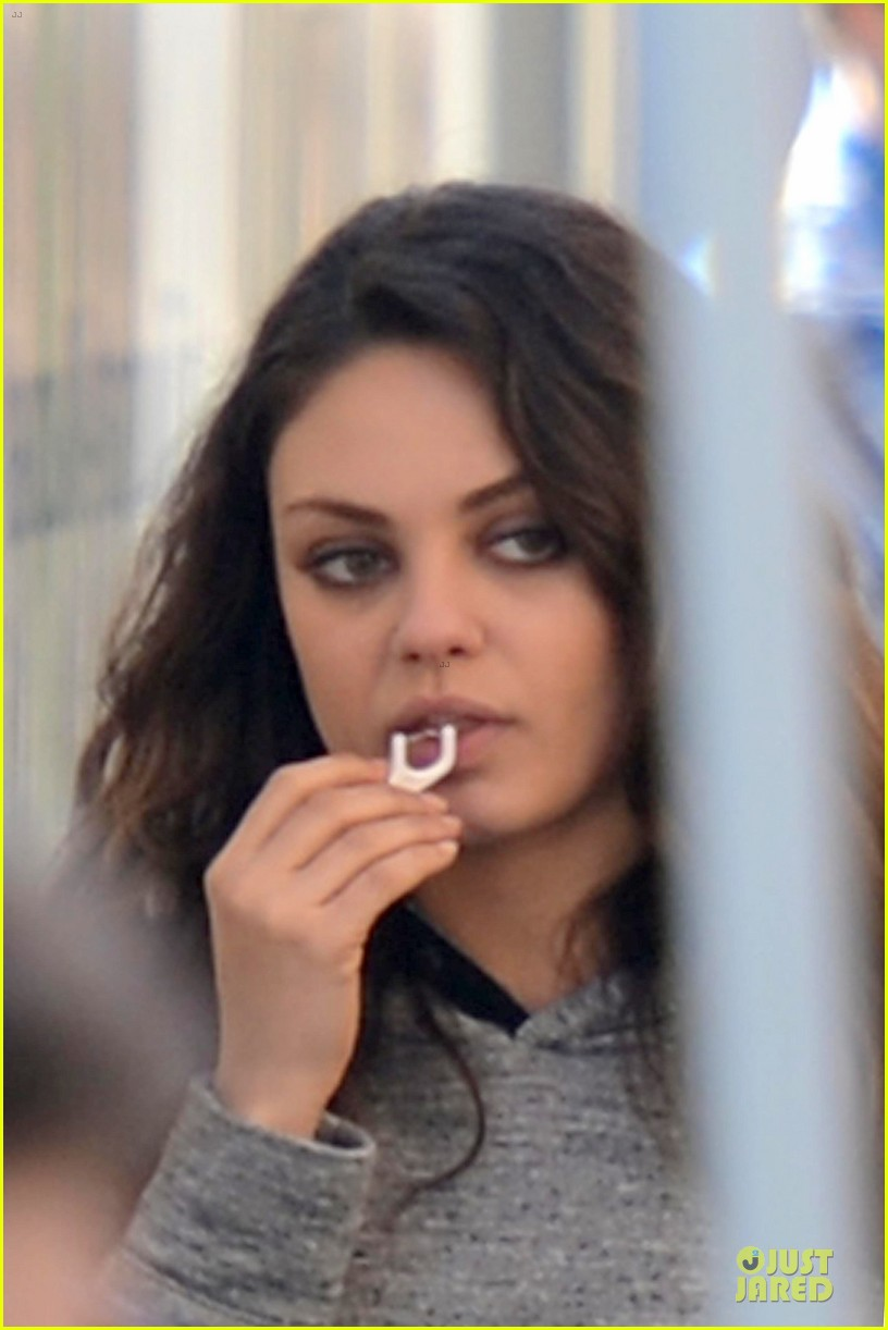 mila kunis teeth cleaning on third person set 322759288