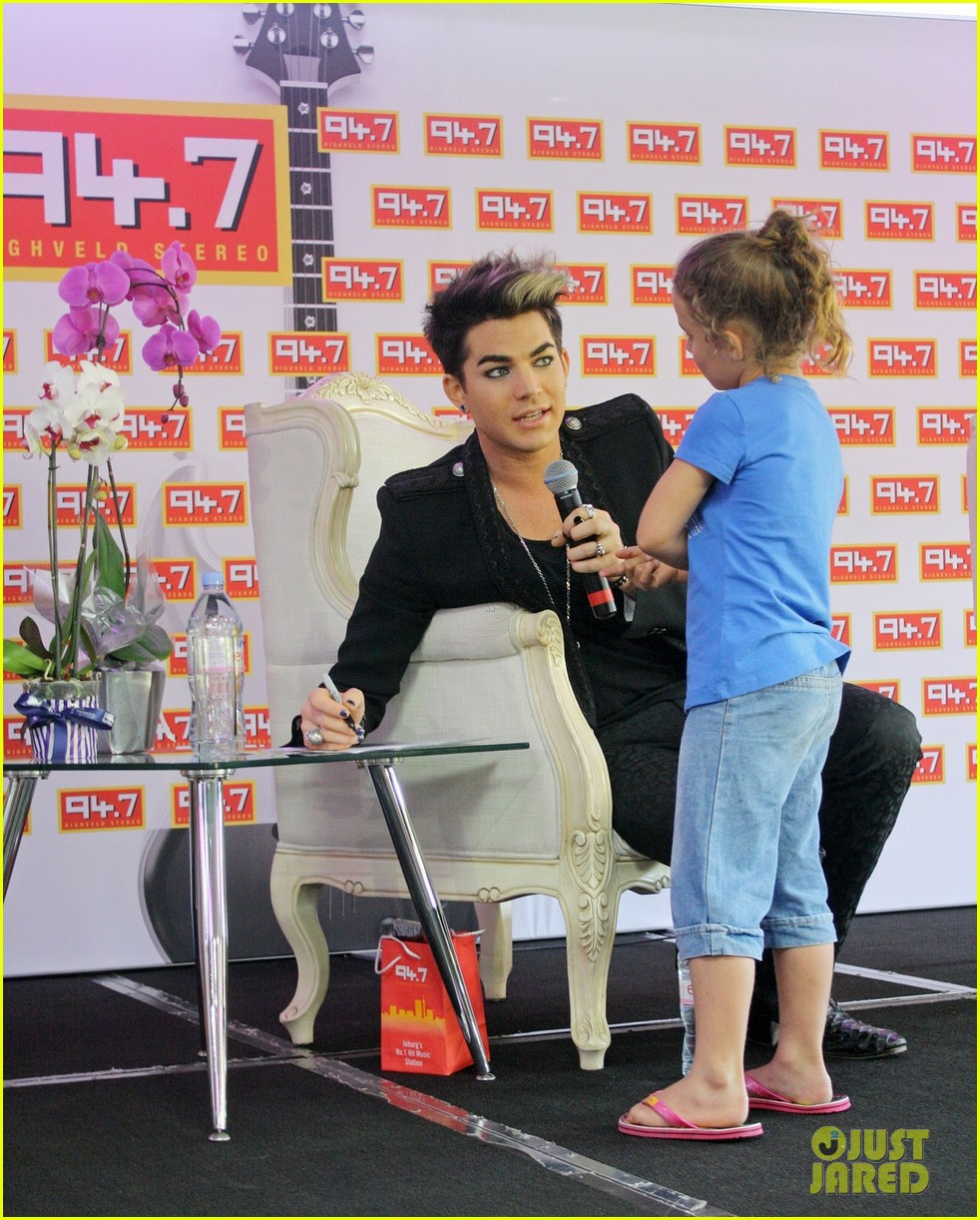 adam lambert hugs lucky young fan in south africa 012759975