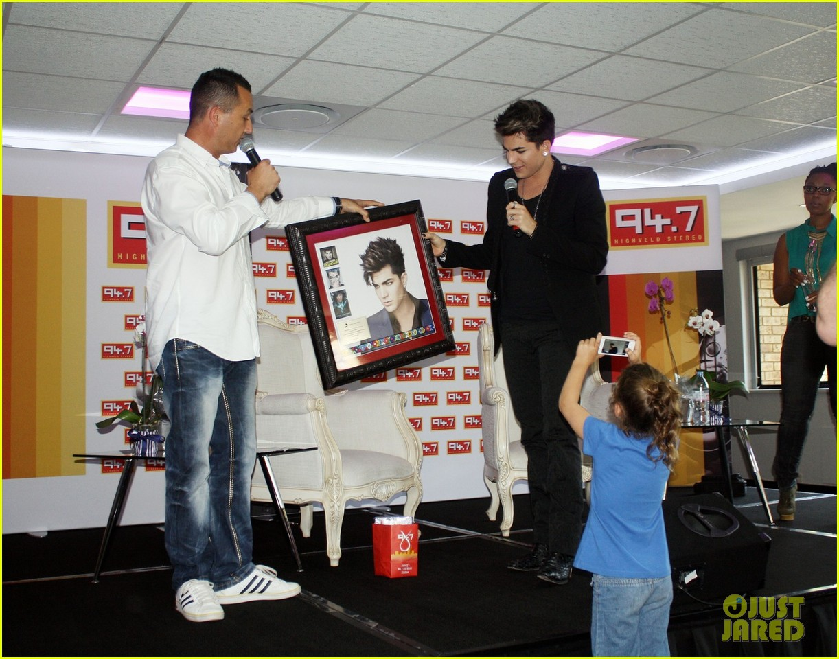 adam lambert hugs lucky young fan in south africa 052759979