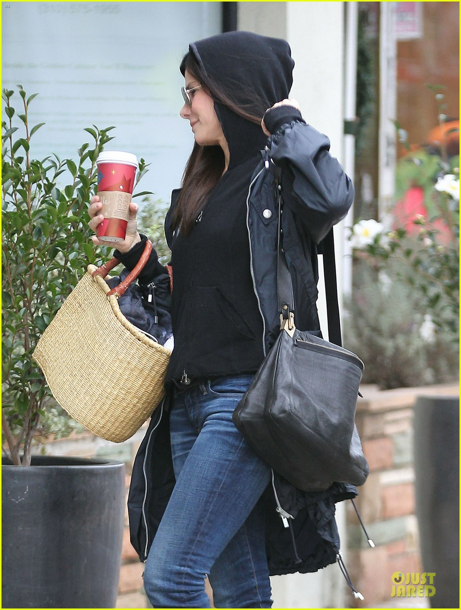 sandra bullock school drop off with rain boots 09