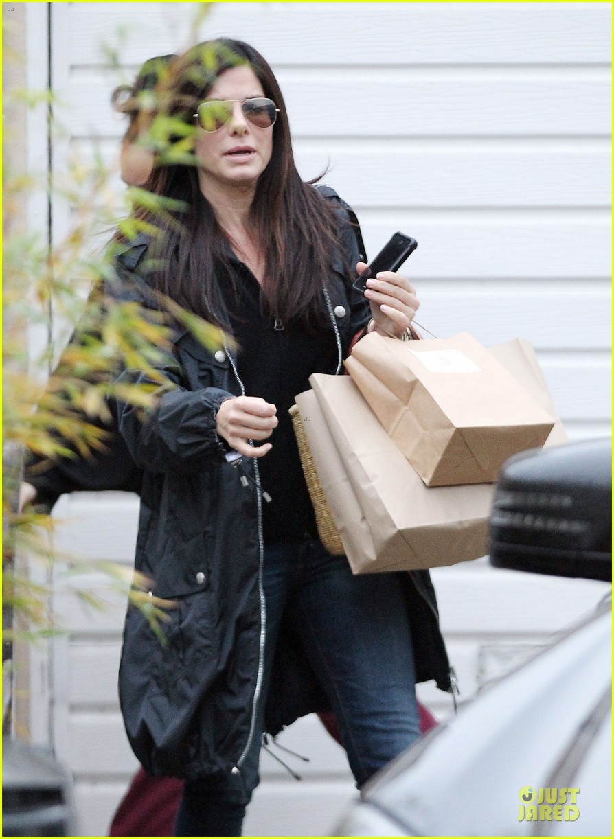 sandra bullock school drop off with rain boots 10