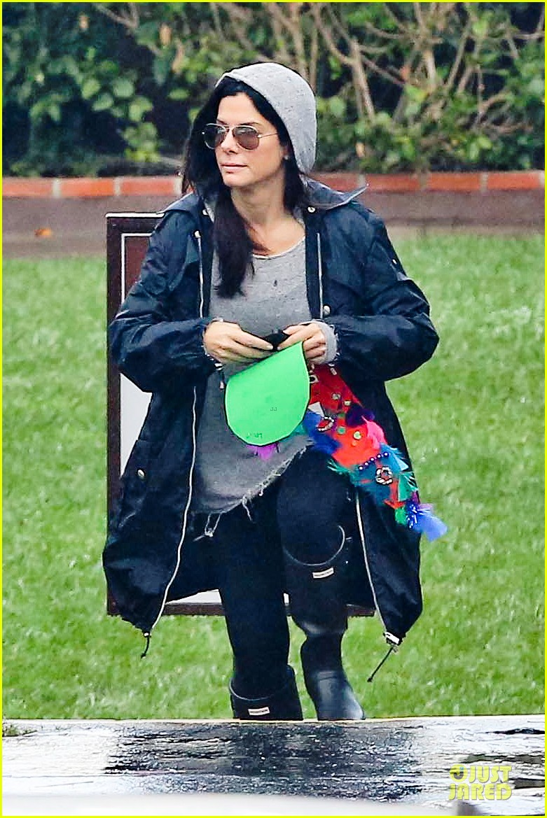 sandra bullock school drop off with rain boots 14