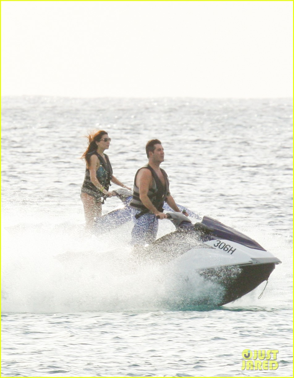 simon cowell jet skiing with former fiancee mezhgan hussainy 062781528